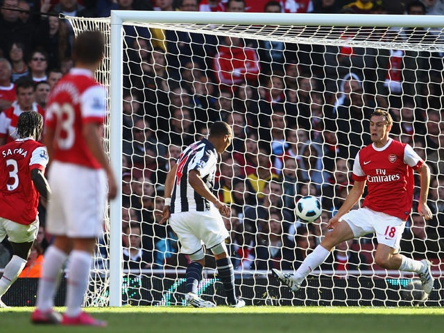 Jerome Thomas of West Bromwich Albion shoots past Laurent Koscielny of Arsenal to score their third goal during the Barclays Premier League match between Arsenal and West Bromwich Albion at the Emirates Stadium on September 25, 2010