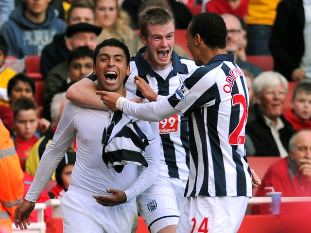 West Bromwich Albion's Chilean defender Gonzalo Jara celebrates scoring with team-mates Northern Irish midfielder Chris Brunt and Nigerian striker Peter Odemwingie during the English Premier League football match between Arsenal and West Bromwich Albion a