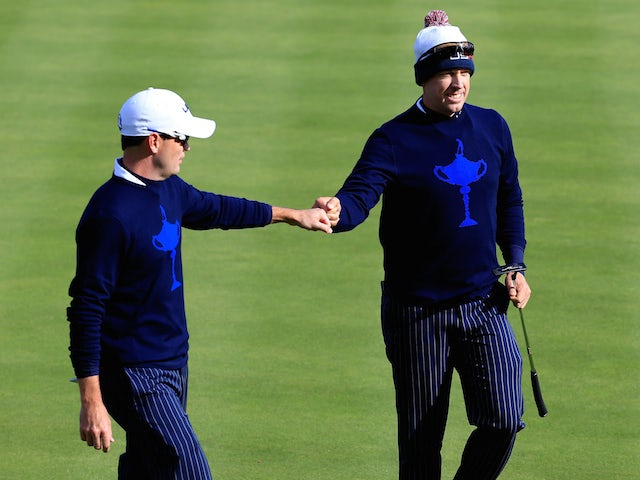 Zach Johnson (L) and Hunter Mahan of the United States celebrate winning the hole on the 4th during the Afternoon Foursomes of the 2014 Ryder Cup on the PGA Centenary Course at Gleneagles on September 26, 2014