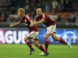 Keisuke Honda of Milan celebrates after scoring the second goal with his team-mate Alex during the Serie A match between AC Milan and AC Chievo Verona at Stadio Giuseppe Meazza on October 4, 2014