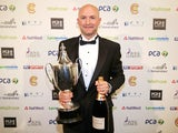 Adam Lyth of Yorkshire with the Reg Hayter Cup for the PCA Player of the Year during the PCA Awards dinner at The Old Billingsgate on October 1, 2014