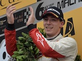 Theodore Racing by Prema's Alex Lynn of Britain celebrates on the podium after winning the Formula Three Macau Grand Prix on November 17, 2013