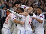 Lyon's French forward Alexandre Lacazette is congratulated by his teammates after scoring a goal during a French L1 football match between Lyon (OL) and Lille (LOSC) on October 5, 2014