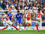 Cesc Fabregas of Chelsea is closed down by Alexis Sanchez and Santi Cazorla of Arsenal during the Barclays Premier League match on October 5, 2014