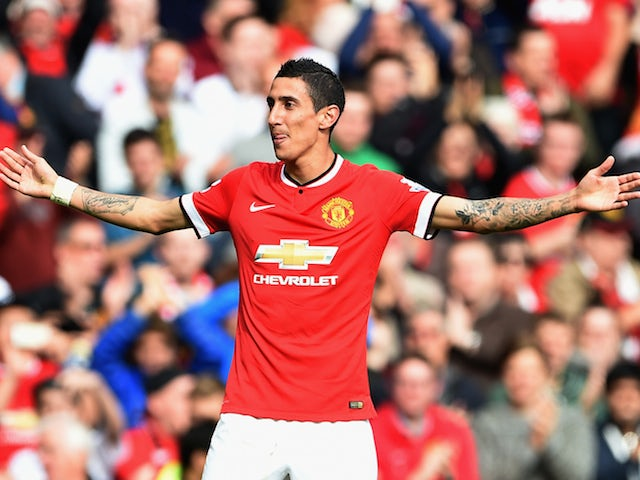 Angel Di Maria of Manchester United celebrates scoring the first goal during the Barclays Premier League match against Everton at Old Trafford on October 5, 2014