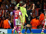 Wojciech Szczesny of Arsenal receives a red card from referee Gianluca Rocchi during the UEFA Champions League group D match between Arsenal FC and Galatasaray AS at Emirates Stadium on October 1, 2014