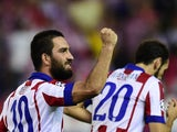 Atletico Madrid's Turkish midfielder Arda Turan celebrates after scoring the first goal during the UEFA Champions League group A football match Atletico de Madrid vs Juventus at the Vicente Calderon stadium in Madrid on October 1, 2014