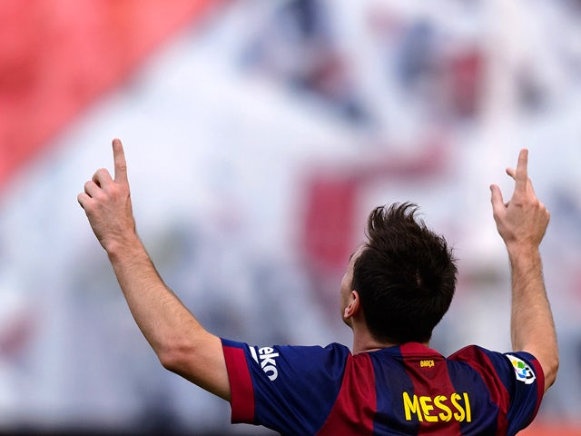 Barcelona's Argentinian forward Lionel Messi celebrates after scoring during the Spanish league football match Rayo Vallecano de Madrid vs Barcelona at the Vallecas stadium in Madrid on October 4, 2014