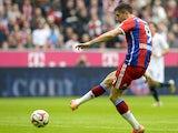 Bayern Munich's Polish striker Robert Lewandowski scores the 1-0 goal during the German first division Bundesliga football match FC Bayern Munich vs Hanover 96 at the Allianz Arena in Munich, southern Germany on October 4, 2014