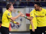 Dortmund's Ciro Immobile celebrates with Pierre-Emerick Aubameyang after scoring a goal during the UEFA Champions League football match RSC Anderlecht vs Borussia Dortmund in Brussels, on October 1, 2014