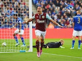 Michael Kightly of Burnley celebrates as he scores their first goal during the Barclays Premier League match between Leicester City and Burnley at The King Power Stadium on October 4, 2014