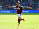 Ross Wallace of Burnley celebrates as he scores their second and equalising goal during the Barclays Premier League match between Leicester City and Burnley at The King Power Stadium on October 4, 2014