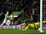 Kris Commons of Celtic scores the first goal during the UEFA Europa League group D match between Celtic and Dinamo Zagreb at Celtic Park on October 02, 2014