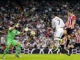 Real Madrid's Portuguese forward Cristiano Ronaldo heads to score during the Spanish league football match Real Madrid vs Athletic Club Bilbao at the Santiago Bernabeu stadium in Madrid on October 5, 2014