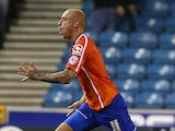 David Cotterill of Birmingham celebrates after scoring a free kick and Birmingham's second goal of the game during the Sky Bet Championship match against Millwall on September 30, 2014