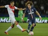 Paris Saint-Germain's Brazilian defender David Luiz (R) challenges Monaco's Argentine midfielder Lucas Ocampos during the French L1 football match on October 5, 2014