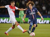 Paris Saint-Germain's Brazilian defender David Luiz (R) challenges Monaco's Argentine midfielder Lucas Ocampos during the French L1 football match on October 5, 2014