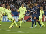 Paris' Brazilian defender David Luiz (3rdR) scores a goal during the UEFA Champions League football match Paris Saint-Germain (PSG) vs Barcelona (FCB) on September 30, 2014