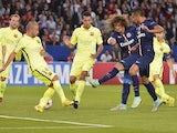 Paris' Brazilian defender David Luiz (3rdR) scores a goal during the UEFA Champions League football match Paris Saint-Germain (PSG) vs Barcelona (FCB) on September 30, 2014
