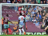 West Ham United's Senegalese striker Diafra Sakho scores their second goal as Queens Park Rangers' English goalkeeper Robert Green (R) looks on during the English Premier League football match on October 5, 2014