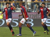 Diego Perotti (L) of Genoa CFC celebrates with his team-mate Sebastian De Maio (C) after scoring the opening goal during the Serie A match against Parma on October 5, 2014