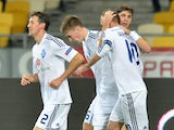 Dynamo Kiev's players celebrate after Andriy Yarmolenko's scoring during an UEFA Europa League group J football match between Dynamo Kiev and Steaua Bucharest in Kiev on October 2, 2014