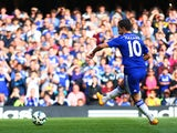 Eden Hazard of Chelsea scores the opening goal from the penalty spot during the Barclays Premier League match between Chelsea and Arsenal at Stamford Bridge on October 4, 2014
