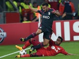 Leverkusen's Brazilian defender Wendell and Benfica's Argentinian forward Eduardo Salvio vie for the ball during the first leg UEFA Champions League Group C football match Bayer 04 Leverkusen vs SL Benfica in Leverkusen, western Germany on October 1, 2014