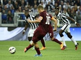 Roma's forward Francesco Totti scores a penalty kick during the Italian Serie A football match Juventus vs Roma on October 5, 2014
