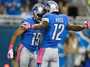 Golden Tate #15 celebrates with Jeremy Ross #12 of the Detroit Lions after a first quarter touchdown agains the Buffalo Bills at Ford Field on October 05, 2014