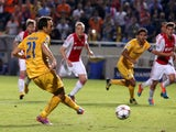 APOEL Nicosia's Gustavo Manduca kicks the ball to score a goal against Ajax Amsterdam during their group F UEFA Champions League football match in the Cypriot capital Nicosia on September 30, 2014