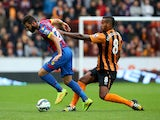 Joe Ledley of Crystal Palace battles for the ball with Tom Huddlestone of Hull City during the Barclays Premier League match between Hull City and Crystal Palace at KC Stadium on October 4, 2014