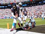 Jay Cutler #6 of the Chicago Bears beats Kawann Short #99 of the Carolina Panthers to the pylon for a touchdown during the first quarter of their game on October 5, 2014