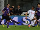 Juan Gillermo Cuadrado of Fiorentina scores his team's second goal during the Serie A match against Inter on October 5, 2014