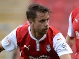 Kari Arnason (L) of Rotherham United in action against Leicester City on August 5, 2014