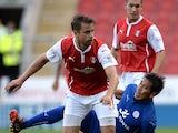 Kari Arnason of Rotherham United challenges Leonardo Ulloa of Leicester City during the Pre Season Friendly match between Rotherham United and Leicester City at The New York Stadium on August 5, 2014