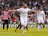 Real Madrid's French forward Karim Benzema celebrates after scoring during the Spanish league football match Real Madrid vs Athletic Club Bilbao at the Santiago Bernabeu stadium in Madrid on October 5, 2014