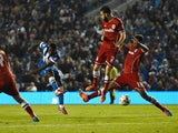 Kazenga LuaLua of Brighton shoots during the Sky Bet Championship match between Brighton & Hove Albion and Cardiff City at Amex Stadium on September 30, 2014