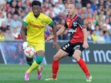 Guingamp's Danish defender Lars Jacobsen (R) vies with Nantes' French midfielder Georges Kevin Nkoudou during the French L1 football match Guingamp vs Nantes on October 5, 2014