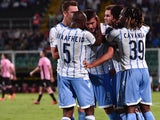 Filip Djordjevic of Lazio celebrates with team mates after scoring the opening goal during the Serie A match between US Citta di Palermo and SS Lazio at Stadio Renzo Barbera on September 29, 2014