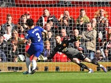 Leighton Baines of Everton takes and has a penalty kick saved by David De Gea of Manchester United during the Barclays Premier League at Old Trafford on October 5, 2014