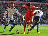 Liverpool's English midfielder Raheem Sterling vies with West Bromwich Albion's Costa Rican defender Cristian Gamboa and West Bromwich Albion's English defender Joleon Lescott during the English Premier League football match between Liverpool and West Bro