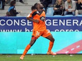 Lorient's French Togolese forward Gilles Sunu celebrates after scoring a goal during the French L1 football match between Bastia and Lorient at the Armand Cesari stadium in Bastia on the French Mediterranean island of Corsica on October 4, 2014