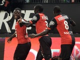 Rennes' French Cameroonian forward Paul-Georges Ntep celebrates with teammates after scoring a goal during the French L1 football match between Rennes and Lens at the Route de Lorient stadium in Rennes, western France, on October 4, 2014