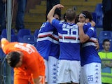 Manolo Gabbiadini of UC Sampdoria celebrates the goal of 1-0 with his team player during the Serie A match against Atalanta on October 5, 2014