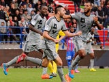 Marseille's French forward Andre-Pierre Gignac celebrates with teammates after scoring a goal during the French L1 football match between Caen and Marseille at the Michel d'Ornano stadium in Caen, western France, on October 4, 2014