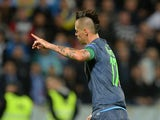 Napoli's captain Marek Hamsik celebrates his opening goal during the UEFA Europa League group I football match between SK Slovan Bratislava v SSC Napoli on October 2, 2014