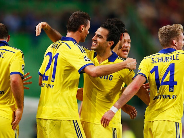 Nemanja Matic of Chelsea (21) celebrates with team mate Cesc Fabregas as he scores their first goal during the UEFA Champions League Group G match against Sporting Lisbon on September 30, 2014