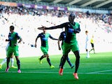Newcastle player Papiss Cisse celebrates after scoring the first Newcastle goal during the Barclays Premier League match between Swansea City and Newcastle United at Liberty Stadium on October 4, 2014