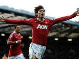 Ji-Sung Park of Manchester United celebrates scoring the opening goal during the Barclays Premier League match between Manchester United and Wolverhampton Wanderers at Old Trafford on November 6, 2010